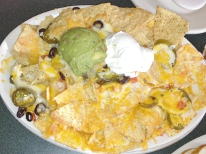 Nachos & cheese with jalapenos and guacamole