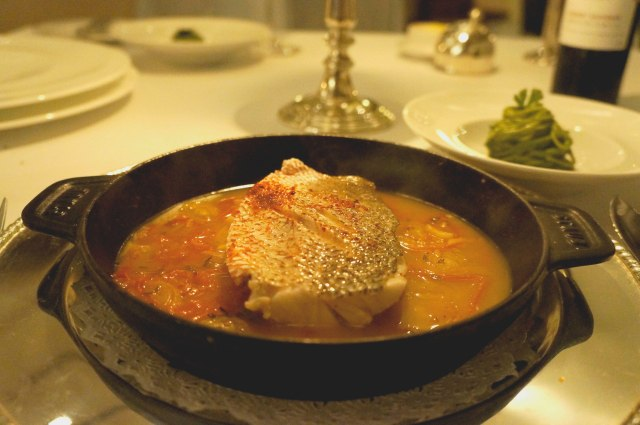 Snapper provencale served with espelette peppers and basil pesto capellini at Le Basilic (Mediterranean) restaurant in Cancun, Mexico
