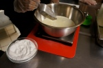 Addition of skim milk powder to make the gelato base during the gelato making class at Mia Chef Gelateria in NYC