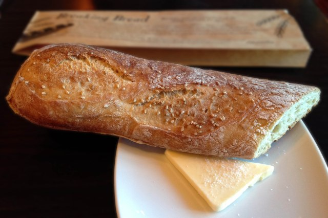 Bread served with a wedge of salt sprinkled butter