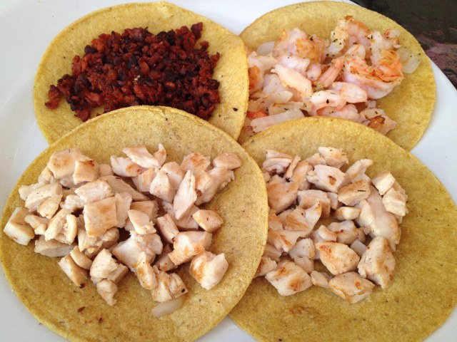 Tacos - clockwise  from top left - Chorizo, shrimp, and chicken, at Taco Grill in La Isla Shopping Mall, Cancun, Mexico