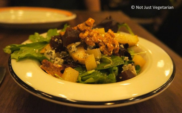 Pear salad with valdeon cheese, quince paste, and candied walnuts at Barraca NYC