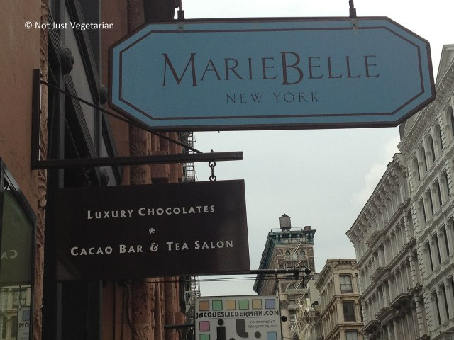 Board at entrance to Marie Belle in SoHo, NYC