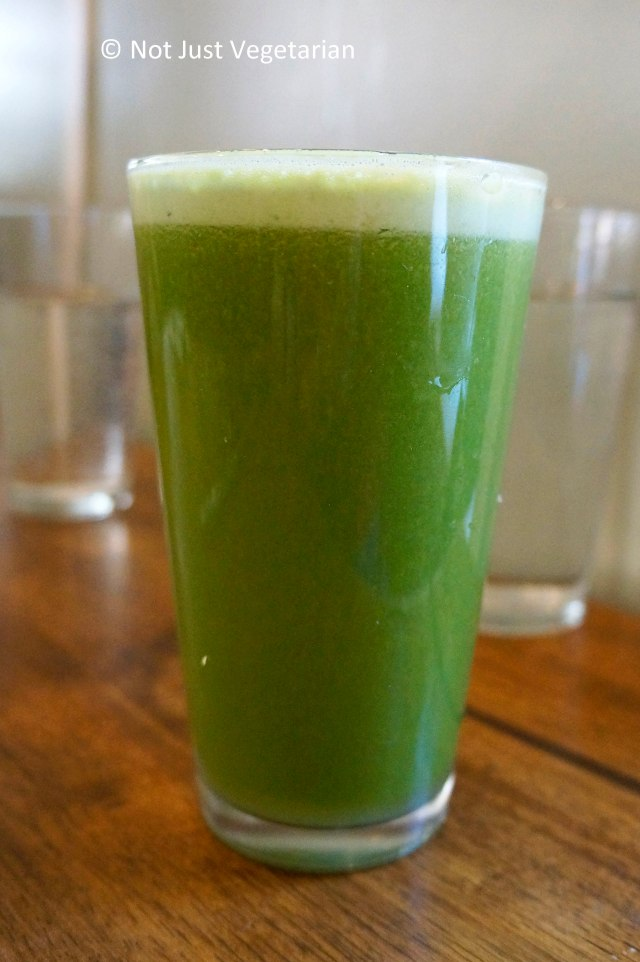 Green lemonade made of mixed greens, apple, lemon juice and ginger root at Peacefood Cafe NYC