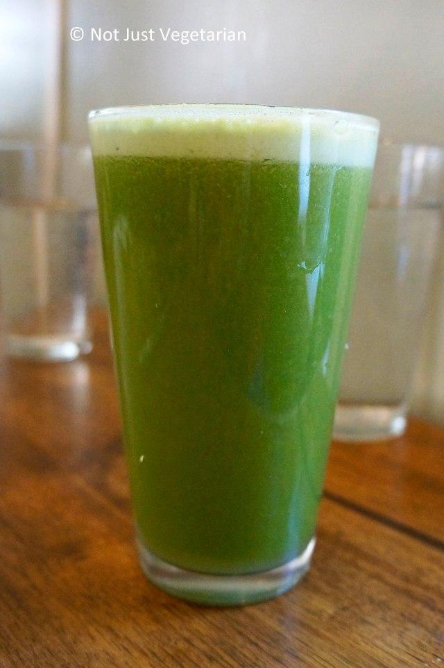 Green lemonade made of mixed greens, apple, lemon juice and ginger root at Peacefood Cafe NYC