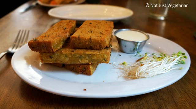 Vegan chickpea fries with Indian spices and a house dipping sauce at Peacefood Cafe NYC
