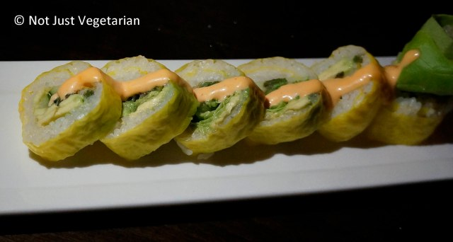 The Vegetariano roll - with asparagus scallion tempura, avocado,  sambhal aioli, and soy paper - at Zengo NYC