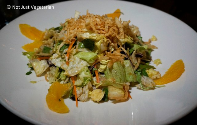 Piloncillo Green salad with cabbage, togarashi pecans, orange, wontons in a piloncillo-ginger vinaigrette at Zengo NYC
