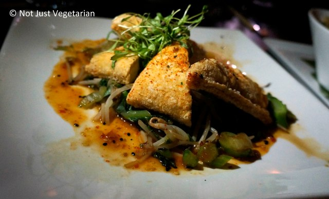Crispy Tofu with bok choi, bean sprouts, ginger, cilantro, sesame chile sauce at Zengo NYC