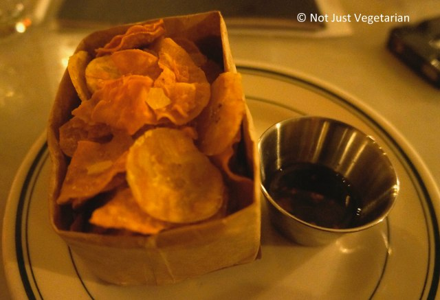 Salted and sweet crispy plantain chips served with a spicy dipping sauce at Oficina Latina NYC