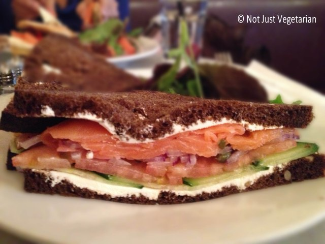 Smoked salmon on pumpernickel bread with cream cheese, cucumber,onions and tomatoes at Cafe Champignon, NYC