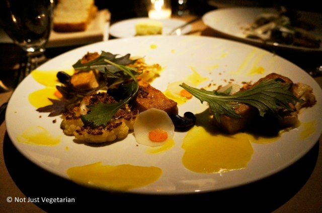 Cashew entree served with roasted cashew nuts, caramelized cauliflower florets, black garlic, and turmeric at Gwynnett St. NYC