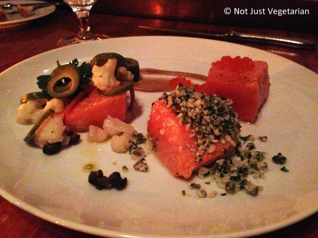 Olive oil poached salmon served with sliced olives and trout roe at Hearth NYC