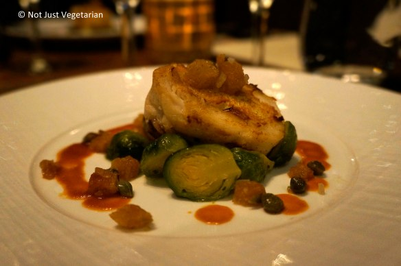 Seared skate wing entree with brussels sprouts fondue, crispy croutons in spicy jus, and capers at Jeanne & Gaston NYC