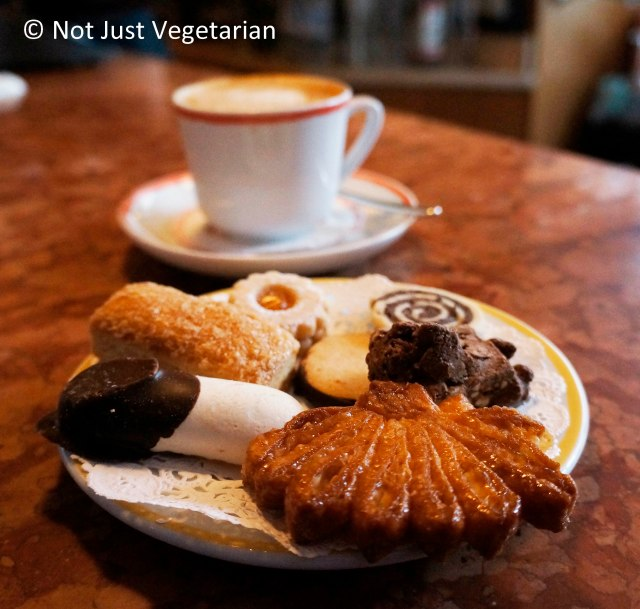 Mini cookie platter with a capuccino at Sant Ambroeus in the West Village