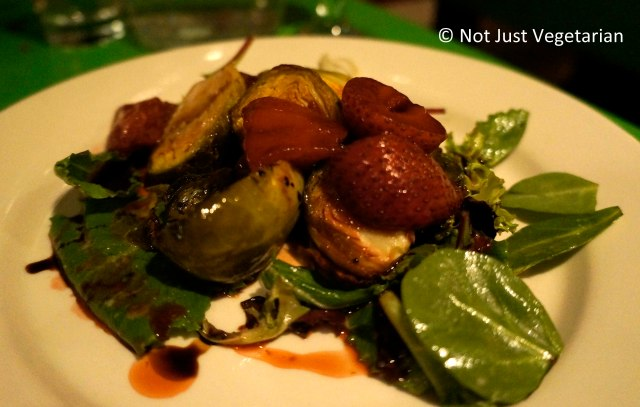 Seasonal special of char-griled Brussels sprouts with balsamic roasted strawberries at Table Verte NYC