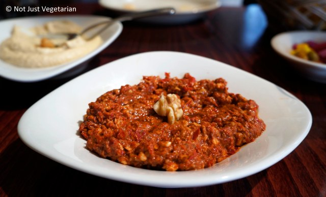Mhammara - roasted sweet red peppers, walnuts, pomegranate molasses, and spices at Tanoreen NYC