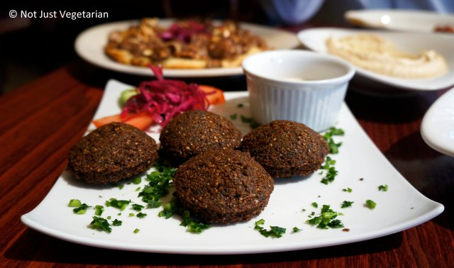 Falafels served with tahini and tomatoes at Tanoreen NYC