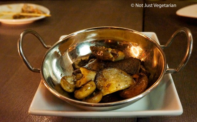 Roasted mushrooms with chopped herbs and truffle eesence at Barn Joo NYC