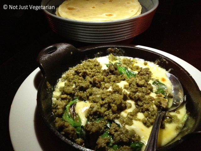 Queso fundido with green chorizo and spinach served with warm tacos at Empellon Taqueria NYC
