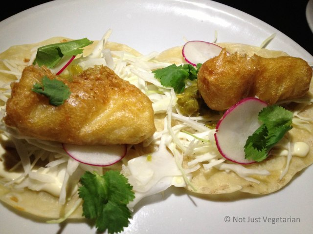 Fish tempura tacos with shredded cabbage and lime mayonnaise and a spicy salsa verde at Empellon Taqueria NYC