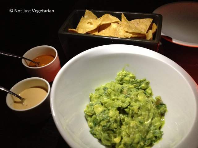 Guacamole served with smoked cashew salsa and arbol salsa and tortilla chips at Empellon Taqueria NYC