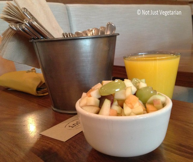 Fruit salad and an orange juice a Indie Food and Wine, NYC