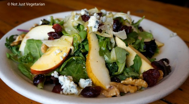 Autumn salad with endives, pears, walnuts, and cranberries at 'sNice cafe in the West Village in NYC