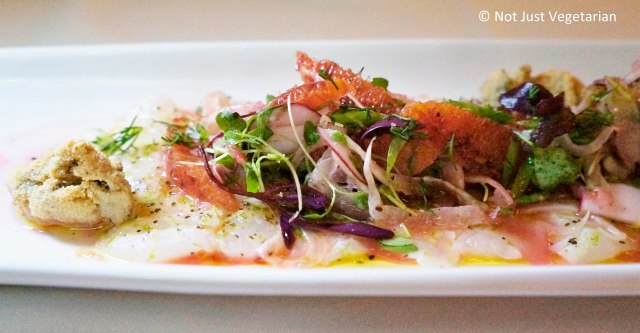 Fluke crudo with fennel, blood orange, fried Kumamoto oysters, and organic  microgreens at Thalassa NYC