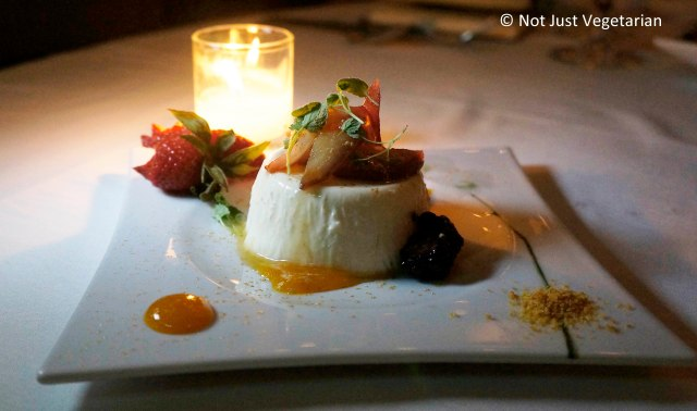 Mastiha panna cotta served with berries at Thalassa NYC