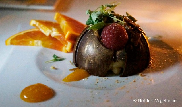 Ekmek - kataifi and cream with pistachios, wrapped in a Valhroha chocolate dome - at Thalassa NYC