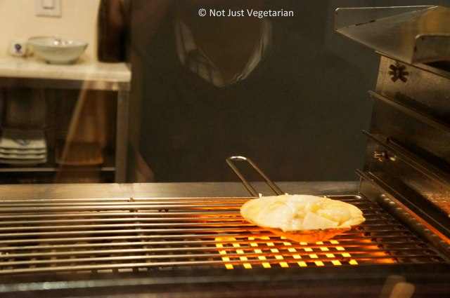 Scallops being grilled at Yopparai NYC