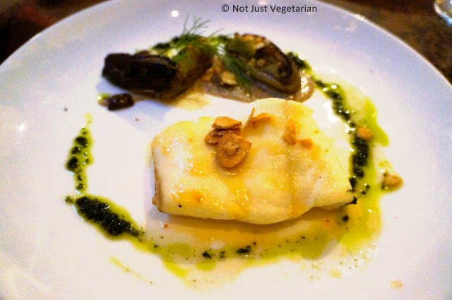 Day boat halibut with almond polenta, fennel, olives, and green curry pistou  at Greenwich Project NYC