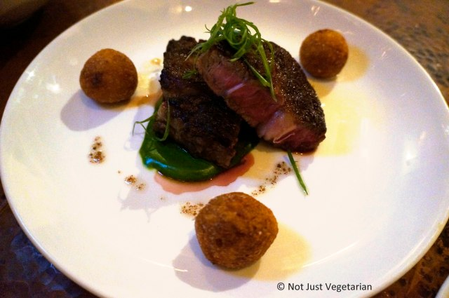 Rib eye with spinach and loaded potato at Greenwich Project NYC
