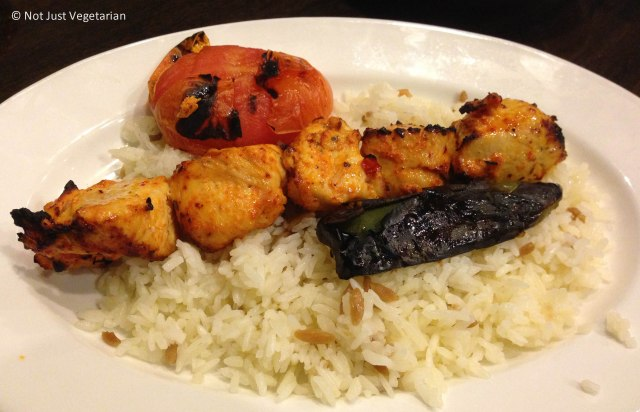 Chicken sheesh kebab with a grilled tomato, a grilled pepper and warm rice at Rumi Turkish Grill in Jersey City