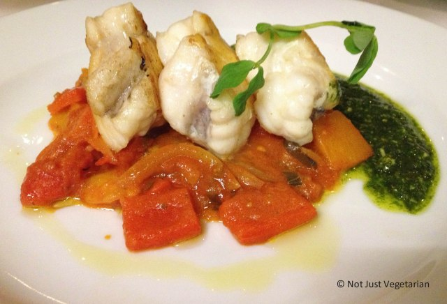 Monkfish with peperonata and basil oil at Stuzzico in London