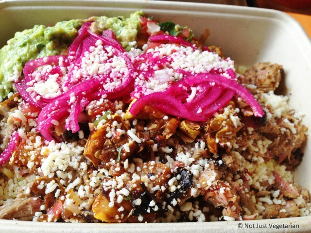 Burrito (bowl) with slow-cooked tender pork, with grllled squash, yellow rice, pinto beans, pickled onions, cotija cheese, and guacamole at Tres Carnes NYC