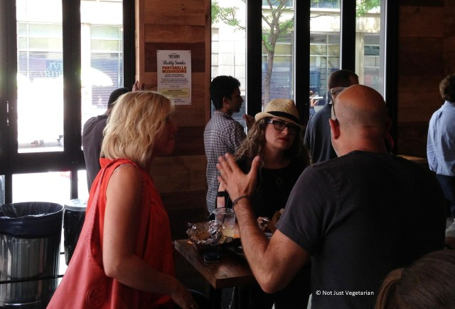 Chef Sasha Shor with guests during the busy lunch hour at Tres Carnes NYC