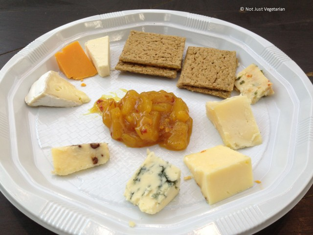"""Cheese platter for one by the Truckle Cheese Co.  - Blue Stilton at 6 o'clock position,  chocolate cheddar at 7 o'clock, brie at 10 o""""clock, Rec Leicester at 11 o""""clock and Chili Cheddar at 2 o""""clock - at the GBBF 2013 in London"""