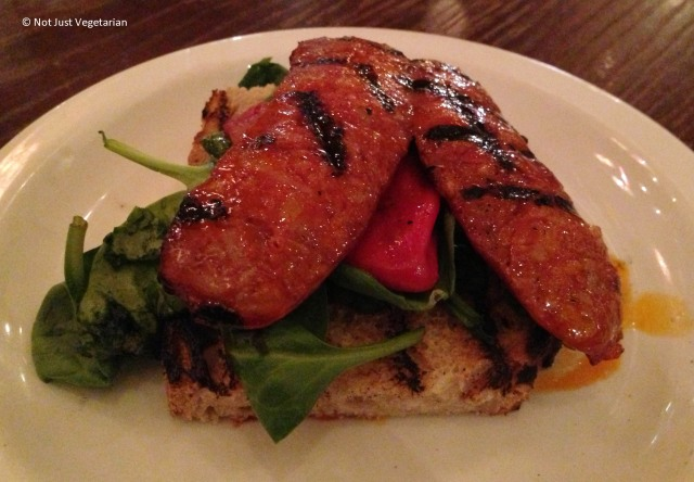 Grilled smoked chorizo on toast with piquillo pepper and rocket at Casa Brindisa in London