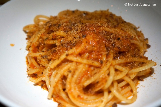 Spaghetti with Tomato sauce and toasted bread crumbs sprinkled on top  at L'Apicio in NYC