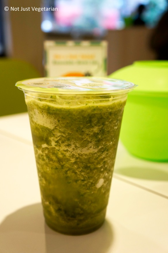 Detoxer Juice (Kale, apple, pineapple, and lemon) with a hemp protein boost at Just Salad in NYC