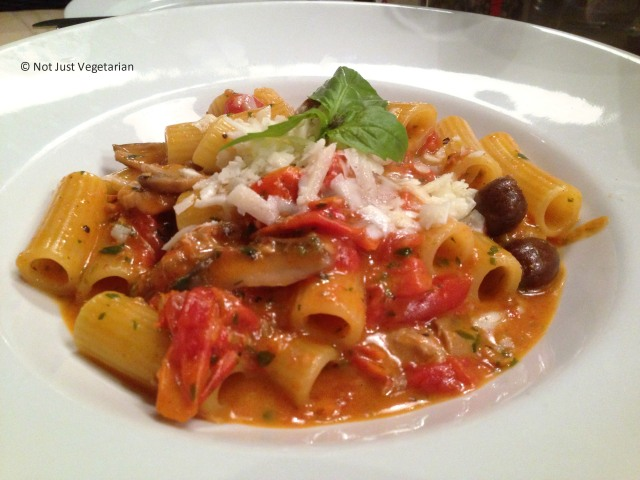 Cacciatora - rigatoni pasta with chicken, mushrooms, olives and pecorino cheese in a cherry tomato sauce - at Rossopomodoro on Fulham Road, London