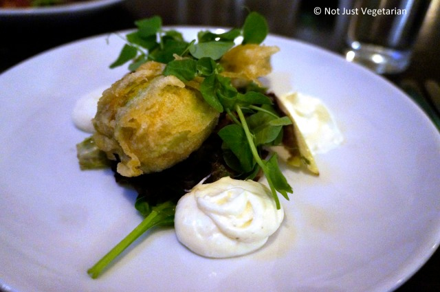 Courgette Flower - Filled with fava bean, feta cheese mint and pine nuts, cooked in a crispy batter with puy lentil salsa and preserved lemon aioli - at The Gate Islington - London