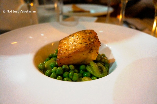 Grilled salmon fillet served on peas and fava beans at Giano NYC