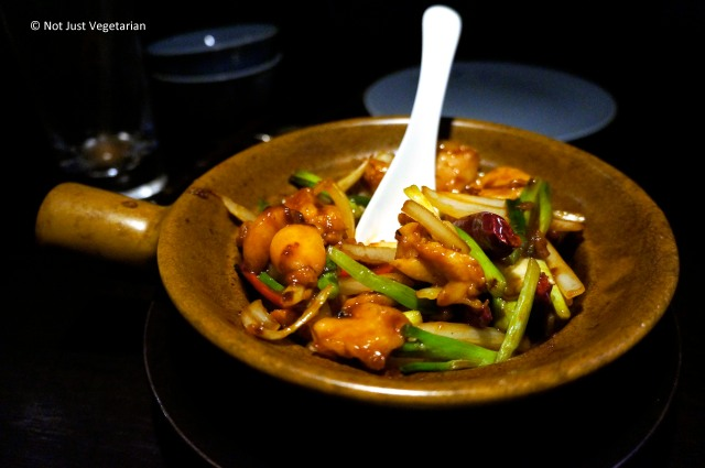 Stir-fried chicken with red chilies and spring onions at Hakkasan Mayfair in London
