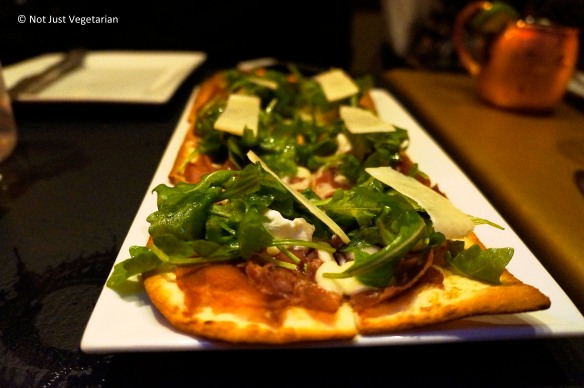 Flat bread with arugula, goat cheese, fig, prosciutto and some pecorino romano at Masq restaurant and lounge, NYC