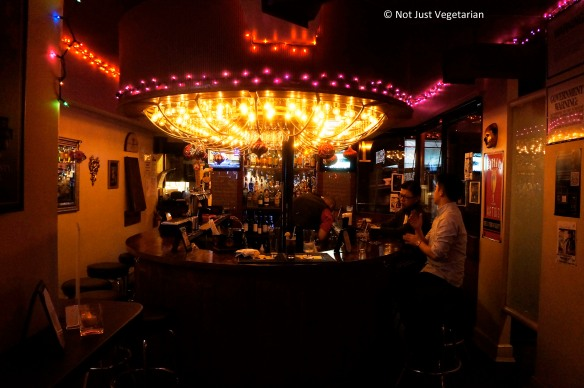 Horse-shoe shaped bar at Masq restaurant and lounge NYC