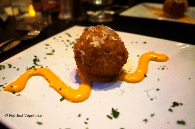 Mac 'n cheese croquette on a spicy remoulade at Masq restaurant and lounge NYC