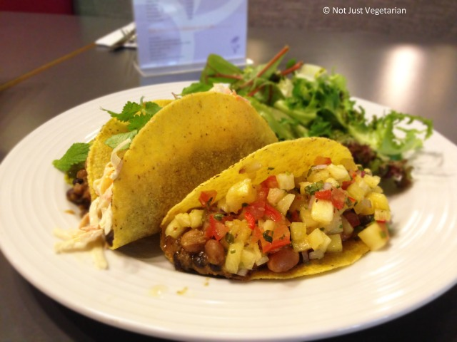 Vegan and gluten free corn tacos with blackened beans, chili fruit salsa at SAF in London